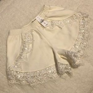 LF cream shorts with lace trim, size 6